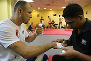 """Igor Svirid, One middleweight world champion from Kazakstan in Red locker room getting hands bandaged and practicing before fight<br /><br />MMA. Mixed Martial Arts """"Tigers of Asia"""" cage fighting competition. Top professional male and female fighters from across Asia, Russia, Australia, Malaysia, Japan and the Philippines come together to fight. This tournament takes place in front of a ten thousand strong crowd of supporters in Pelaing Stadium. Kuala Lumpur, Malaysia. October 2015"""