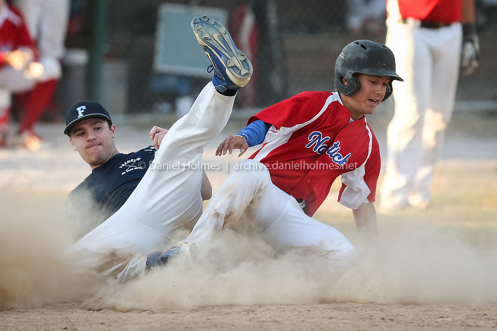 (7/21/16, NATICK, MA) Natick's Andrew Ciampa slides into home safely with Franklin pitcher Matt Dumart trying to make the play during the Senior Babe Ruth baseball game against Franklin at Natick High School on Thursday. Daily News and Wicked Local Photo/Dan Holmes