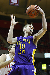 29 December 2011:  Seth Tuttle grabs a rebound during an NCAA mens basketball game between the Northern Illinois Panthers and the Illinois State Redbirds in Redbird Arena, Normal IL