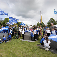 """THe Earl of Moray, pictured between the plinths on the left is Andrew de Moray's direct descendent and unveils the lecterns with the help of the local children from St Ninians Primary School.<br /> <br /> BRAVEHEART HEROES, WILLIAM WALLACE AND ANDREW DE MORAY, FINALLY HONOURED AT STIRLING BRIDGE BATTLE SITE AS SALTIRE RAISED FOR FIRST TIME IN OVER 700 YEARS<br /> <br /> Friday 29th May, 2015<br /> <br /> IT'S TAKEN more than 700 years but today, the two heroes at the centre of one of the most important battles in Scottish history have been jointly honoured at the spot where they both led an outnumbered Scottish army to victory against the English.<br /> The formal unveiling ceremony at Stirling Bridge today (Friday 29th May), of three lecterns made of traditional Scottish whinstone dedicated to the memory of William Wallace and Andrew de Moray,at site of the historic victory at Battle of Stirling Bridge.<br /> At a special ceremony attended by Andrew de Moray's direct descendant, the Earl of Moray, and Stewart Maxwell, MSP, convener of the Scottish Parliament's Education and Culture Committee, the memorials were formally unveiled.Mr Maxwell opened the event and after the dedication, together with the Earl of Moray, they raised the Saltire together at the site of the Battle of Stirling Bridge. This is the first time in over 700 years that the Saltire has flown at Stirling Bridge. The flag will now become a permanent fixture at the site of the Battle.<br /> John Stuart, the current Earl of Moray, said of his illustrious kinsman: """"I am delighted that Andrew de Moray is finally, after 700 years, to have the recognition he deserves. The Guardians of Scotland have put a huge amount of time and effort into the lecterns, which are a very fitting tribute to one of Scotland's greatest patriots.""""<br /> The victory represented a key moment in the Scottish Wars of Independence. Eminent Scots historian, Sir Tom Devine, recently described the battle as being 'second in importance """