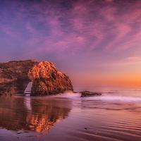Sea arch at sunset, Natural Bridges State Beach, Santa Cruz, California.