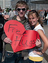 Two American teenager Christians offering Free Hugs in Alexanderplatz in Mitte Berlin Germany