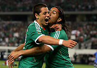 Fotball<br /> Foto: imago/Digitalsport<br /> NORWAY ONLY<br /> <br /> 05.06.2011<br /> <br /> Mexico forward Jesus De Nigris (9) gets hug from Mexico forward Javier Hernandez (14) after his goal during the 5-0 Mexico victory over El Salvador in the first round of the CONCACAF Gold Cup game played at Cowboys Stadium in Arlington