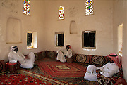 Saudis relaxing inside the Palace of Ibn Madi, now a museum, oasis town of Najran