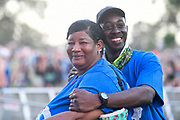 Two security guards pose for a photo in between sets at The Other Stage during The Bonnaroo Music and Arts Festival