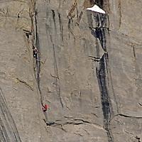 BAFFIN ISLAND, Nunavut, Canada. Climbers on steep lower wall, Great Sail Peak (Stewart Valley)