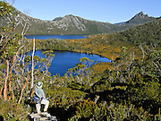 Walk along Lake Lilla and Dove Lake, in Cradle Mountain - Lake Saint Clair National Park, Tasmania, Australia. The most extensive dolerite formations in the world dominate the landscape of Tasmania, where magma intruded into a thin veneer of Permian and Triassic rocks over perhaps a million years during the Jurassic breakup of supercontinent Gondwana in the Southern Hemisphere, forming vast dolerite/diabase sills and dike swarms. (North American geologists use the term diabase instead of dolerite to refer to the fresh, unaltered rock.) The Tasmanian Wilderness was honored as a UNESCO World Heritage Site in 1982, expanded in 1989.