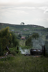 """2 March 2017, Morija, Maseru district, Lesotho: Smoke coming up from the hospital incinerator, used to disinfect medical equipment. Scott Hospital is run by the Lesotho Evangelical Church in Southern Africa and is a founding member of the Christian Health Association of Lesotho. It is located in the village of Morija, and operates and supervises clinics in the Maseru District of Lesotho. Scott started out as a dispensary in 1864, and today offers comprehensive healthcare Mondays-Fridays, as well as pharmaceutical services around the clock. Lesotho suffers from high numbers in Tuberculosis in disesase and mortality, and so the hospital screens all patients for TB. The hospital observes among many patients what they describe as """"low health-seeking behaviour"""", services are increasing and demand rising, but space and human resources are a challenge, as is funding. I key concern is one of infrastructure, where the original design of the hospital matches poorly with current needs, as departments and buildings are scattered, posing a challenge for security. Another challenge is to adapt donation structures, so as to be able to receive payments electronically. The hospital has one ambulance, which they describe as not enough, but what they have. Another challenge is that lack of funds affects maintenance of buildings and infrastructure, as the immediate care of patients take priority. PLEASE NOTE: This photo is not to be used in social media."""