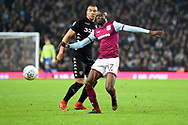Aston Villa midfielder Albert Adomah (37) shields the ball from Leeds United striker Jay-Roy Grot (11) during the EFL Sky Bet Championship match between Aston Villa and Leeds United at Villa Park, Birmingham, England on 13 April 2018. Picture by Dennis Goodwin.
