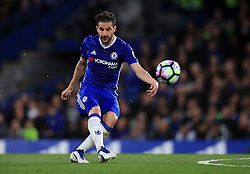 """Chelsea's Cesc Fabregas shoots during the Premier League match at Stamford Bridge, London. PRESS ASSOCIATION Photo. Picture date: Monday May 8, 2017. See PA story SOCCER Chelsea. Photo credit should read: Mike Egerton/PA Wire. RESTRICTIONS: EDITORIAL USE ONLY No use with unauthorised audio, video, data, fixture lists, club/league logos or """"live"""" services. Online in-match use limited to 75 images, no video emulation. No use in betting, games or single club/league/player publications."""