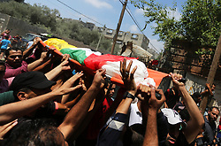 July 5, 2018 - Gaza City, Gaza Strip, Palestinian Territory - Mourners carry the body of Palestinian Mahmoud al-Ghrabli ,16, who died of wounds he sustained during clashes with Israeli troops, his funeral in Gaza City.  (Credit Image: © Ashraf Amra/APA Images via ZUMA Wire)