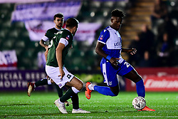 Rollin Menayese of Bristol Rovers is marked by Scott Wootton of Plymouth Argyle - Mandatory by-line: Ryan Hiscott/JMP - 17/12/2019 - FOOTBALL - Home Park - Plymouth, England - Plymouth Argyle v Bristol Rovers - Emirates FA Cup second round replay