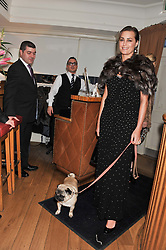 YASMIN LE BON and her dog Luigi at the launch of George's Dinner for Dogs menu in aid of The Dog's Trust held at George, 87-88 Mount Street, London on 19th March 2013.
