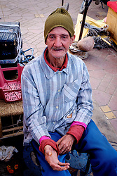 Portrait of a man who earns his living by shining shoes in the Jemaa el Fna, Marrakech, Morocco, North Africa<br /> <br /> (c) Andrew Wilson   Edinburgh Elite media