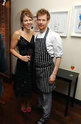 TOM AIKENS and AMBER NUTTALL at a St.Valentine's dinner hosted by Ruinart champagne at Tom Aikens Restaurant, Elystan Street, London on 6th February 2007.<br /><br />NON EXCLUSIVE - WORLD RIGHTS