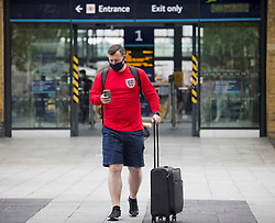 © Licensed to London News Pictures. 10/07/2021. London, UK. England fans start to arrive at Kings Cross station in London ahead of the EURO 2020 final at Wembley between England and Italy tomorrow evening (Sunday). Photo credit: Ben Cawthra/LNP