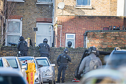 © Licensed to London News Pictures. 22/01/2021. London, UK. Armed  police surround a property in Southall, west London where they are currently involved in a standoff with a man, reported to be in possession of a firearm, at a residential address. Photo credit: Ben Cawthra/LNP
