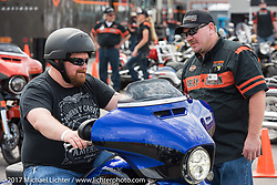 Test riding the new 2017 Harleys at the Harley-Davidson display at the Daytona International Speedway during Daytona Beach Bike Week. FL. USA. Sunday March 12, 2017. Photography ©2017 Michael Lichter.