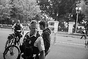 08122018 - Washington, District of Columbia, USA:  A member of the Secret Service looks over his shoulder as counter protesters chase a group of suspected white nationalists, including the man at right, who wandered into a group of counter protesters carrying a Kekistan flag near the White House, August 12, 2018. The Unite the Right 2 rally had just been held near the white house on the anniversary of deadly rally in Charlottesville, Virginia, which left one protester dead. Kekistan, an imaginary white nationalist ethno-state, is an invention of alt-right 4 Chan online forum members and was started as a meme to represent a fake country of Pepe the Frog.