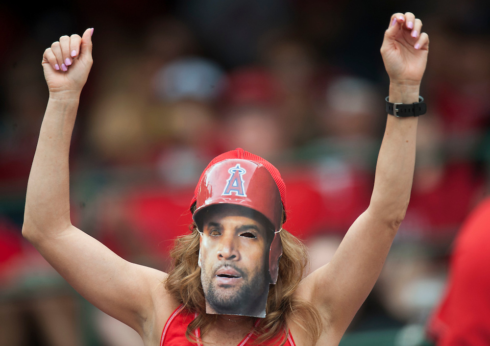 An Angel fan dances with an Albert Pujols mask on during the Angels' 8-6 loss to the Houston Astros Sunday at Angel Stadium. <br /> <br />  //ADDITIONAL INFO:   <br /> <br /> angels.0530.kjs  ---  Photo by KEVIN SULLIVAN / Orange County Register  -- 5/29/16<br /> <br /> The Los Angeles Angels take on the Houston Astros Sunday at Angel Stadium.