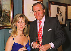 MR & MRS JUSTIN CADBURY at a party in London on 19th May 1998.MHR 5