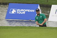 Branden Grace (RSA) in a bunker at the 17th green during Saturay's Round 3 of the 2014 BMW Masters held at Lake Malaren, Shanghai, China. 1st November 2014.<br /> Picture: Eoin Clarke www.golffile.ie