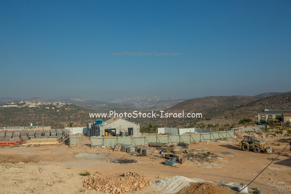 New house are constructed in Einav an Israeli settlement West Bank Israeli children can be seen playing in the construction site