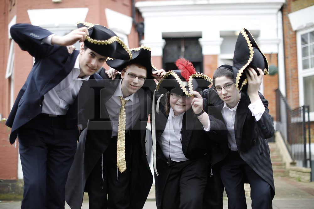 © Licensed to London News Pictures. 12/03/2017. London, UK. Orthodox Jewish children in fancy dress celebrate the festival of Purim in the streets of Stamford Hill in north London on Sunday, 12 March 2017. Purim celebrates the miraculous salvation of the Jews from a genocidal plot in ancient Persia, an event documented in the Book of Esther. Traditionally the jewish community wear fancy dress and exchange reciprocal gifts of food and drink. Photo credit: Tolga Akmen/LNP