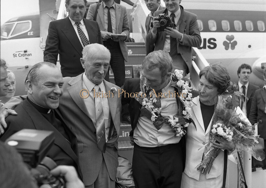 """Fr Niall O'Brien Returns from Captivity.1984..14.07.1984..07.14.1984..On 6 May 1983,Fr Niall O'Brien was arrested along with two other priests, Fr. Brian Gore, an Australian, Fr. Vicente Dangan, a Filipino and six lay workers - the so-called """"Negros Nine"""", for the murders of Mayor Pablo Sola of Kabankalan and four companions. The priests where held under house arrest for eight months but """"escaped"""" to prison in Bacolod City, the provincial capital, where they felt they would be safer.The case received widespread publicity in Ireland and Australia, the home of one of the co-accused priests, Fr. Brian Gore. When Ronald Reagan visited Ireland in 1984, he was asked on Irish TV how he could help the missionary priest's situation. A phone call the next day from the Reagan administration to Ferdinand Marcos resulted in Marcos offering a pardon to Fr. O'Brien and his co-accused..(Ref Wikipedia)...Picture shows Fr Niall O'Brien with his parents Mr and Mrs O'Brien and Cardinal Tomas O Fiach as he descended the aircraft stairs at Dublin Airport."""