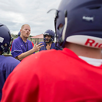 Miyamura Head Coach John Roanhaus talks with his players on the importance of understanding their signals on offense. the Patriots face off against the Aztec Tigers at home on Friday at Miyamura High School in Gallup, NM.
