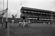 16/05/1965<br /> 05/16/1965<br /> 16 May 1965<br /> National Hurling League Final: Kerry v Laois at Croke Park, Dublin.<br /> Laois goalie, J. Fennell (left), well covered by his backs, stops a high ball from entering the net. Laois players, P. Nolan, L.O'Mahoney, and T. Cuddy are also in the picture with Kerry forwards, T. Driscoll and M. Hennessy.