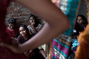 Mayuri Mahesh Pandit, 13, (left) is participating to the Unicef-run 'Deepshikha Prerika' project inside the Milind Nagar Pipeline Area, an urban slum on the outskirts of Mumbai, Maharashtra, India, where she resides with her family.