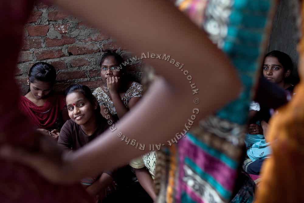 Mayuri Mahesh Pandit, 13, (left) is participating to the Unicef-run 'Deepshikha Prerika' project inside the Milind Nagar Pipeline Area, an urban slum on the outskirts of Mumbai, Maharashtra, India, where she resides with her family.