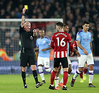 Sheffield United's Oliver Norwood is shown a yellow card by referee Lee Mason<br /> <br /> Photographer Rich Linley/CameraSport<br /> <br /> The Premier League - Sheffield United v Manchester City - Tuesday 21st January 2020 - Bramall Lane - Sheffield<br /> <br /> World Copyright © 2020 CameraSport. All rights reserved. 43 Linden Ave. Countesthorpe. Leicester. England. LE8 5PG - Tel: +44 (0) 116 277 4147 - admin@camerasport.com - www.camerasport.com