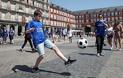 Leicester City fans play football in Plaza Mayor ahead of the game