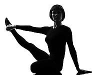 Parivrtta Krounchasana heron pose yoga woman posture position in silouhette on studio white background