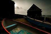 Nominated in 10th (2017) International Colour Awards (Architecture category) <br /> <br /> Now disused by the #RNLI the old Lizard Lifeboat House still stands, now houses the gear of the Lizard fishermen. It is gradually looking more dilapidated each time I visit but it will always stand as a reminder to me, at Britain's most Southerly point, of a place from which the bravest men risked their lives to save the lives of hundreds and hundreds of floundering souls at this notorious peninsula. <br /> <br /> To me, the red is not just the gunwale of a boat, but blood, an artery - a lifeline for the sailors against the darkness of their situation.