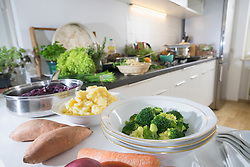 Vegetables and bowls on kitchen counter