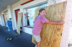 Billy Conley, of Cape Canaveral, FL, USA, lifts a piece of plywood to place over a window at a business on Wednesday, Oct. 5, 2016. Preparations have begun to evacuate Florida's coastal communities as Hurricane Matthew approaches. Photo by Red Huber/ Orlando Sentinel/TNS/ABACAPRESS.COM