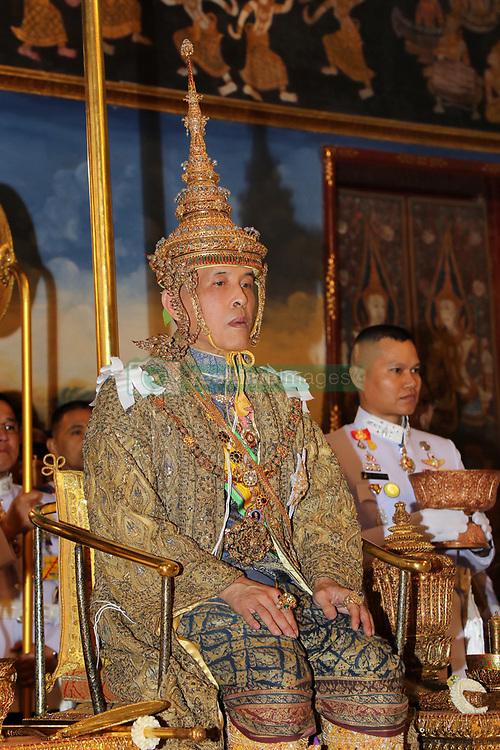 04-05-2019 Thailand King Maha Vajiralongkorn Bodindradebayavarangkun (Rama X), with Queen Suthida, sits under the Royal Nine-tiered Umbrella at Baisal Daksin Throne Hall in Bangkok. 04 May 2019 Pictured: 04-05-2019 Thailand King Maha Vajiralongkorn Bodindradebayavarangkun (Rama X), with Queen Suthida, sits under the Royal Nine-tiered Umbrella at Baisal Daksin Throne Hall in Bangkok. Photo credit: Committee coronation/POOL / MEGA TheMegaAgency.com +1 888 505 6342