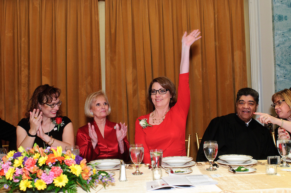 Advocates Society incoming President, Cook County Assistant Public Defender Michelle S. Hendrickson waves as she is introduced during the 82nd Annual Installation and Awards Dinner of the association of Polish-American lawyers at the Drake Hotel on Wednesday, February 6th. Seated with Hendrickson from left to right are outgoing Society President Regina L. Rathnau, Illinois Appellate Couty Judge Aurelia Pucinski, Cook County Circuit Court Chief Judge Timothy C. Evans and Cook County Circuit Court Judge Diann K. Marsalek. © 2013 Brian J. Morowczynski ViaPhotos
