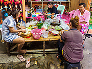 20 MAY 2017 - BANGKOK, THAILAND: A family in Pom Mahakan prepares vegetables for a family dinner. They are facing eviction, although the date of their eviction hasn't been announced yet. The final evictions of the remaining families in Pom Mahakan, a slum community in a 19th century fort in Bangkok, have started. City officials are moving the residents out of the fort. NGOs and historic preservation organizations protested the city's action but city officials did not relent and started evicting the remaining families in early March.        PHOTO BY JACK KURTZ