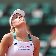 2017 French Open Tennis Tournament - Day One.  Angelique Kerber of Germany reacts during her loss to Ekaterina Makarova of Russia on Court Philippe-Chatrier during the Women's Singles Round one match at the 2017 French Open Tennis Tournament at Roland Garros on May 27th, 2017 in Paris, France.  (Photo by Tim Clayton/Corbis via Getty Images)