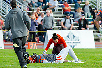 KELOWNA, BC - OCTOBER 6: Athletic therapist Sammy Levin tends to Jordan Robinson #51 of Okanagan Sun on the field against the VI Raiders at the Apple Bowl on October 6, 2019 in Kelowna, Canada. (Photo by Marissa Baecker/Shoot the Breeze)
