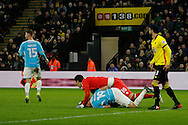 Burton Albion striker Luke Varney (19) has a collision with Watford goalkeeper Costel Pantilimon (30) and is brought off the field on a spinal board during the The FA Cup 3rd round match between Watford and Burton Albion at Vicarage Road, Watford, England on 7 January 2017. Photo by Richard Holmes.