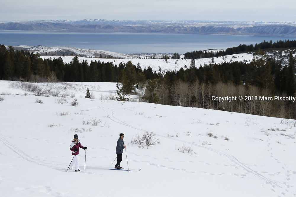 """SHOT 3/11/18 9:41:10 AM - Winter activities including cross country skiing, snowshoeing, tubing and winter fishing on Bear Lake in Garden City, Utah. Bear Lake is a natural freshwater lake on the Utah-Idaho border in the Western United States. The lake has been called the """"Caribbean of the Rockies"""" for its unique turquoise-blue color, which is due to the reflection of calcium carbonate (limestone) deposits suspended in the lake. Bear Lake is over 250,000 years old. (Photo by Marc Piscotty / © 2018)"""