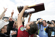 04 December 2011: Stanford's Alina Garciamendez holds the championship trophy overhead. The Stanford University Cardinal defeated the Duke University Blue Devils 1-0 at KSU Soccer Stadium in Kennesaw, Georgia in the NCAA Division I Women's Soccer College Cup Final.