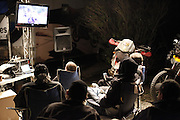 Riders watching video at Touratech USA tent at 2010 Rawhyde Adventure Rider Challenge