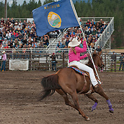 Jadyn Schaeffer carries the Montana state flag during the opening of the Darby MT EPB.  Josh Homer photo.  Photo credit must be given on all uses.