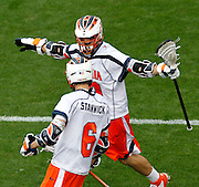 Virginia Cavaliers Chris Bocklet (10) celebrates the goal of teammate Steele Stanwick (6) during the game in Charlottesville, VA. Johns Hopkins defeated Virginia 11-10 in overtime. Photo/Andrew Shurtleff